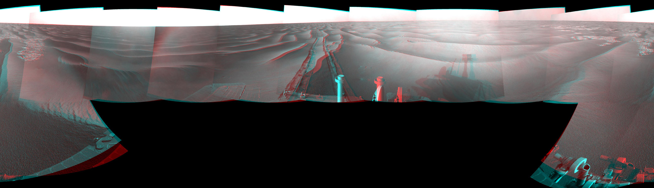 This stereo mosaic of images from NASA's Mars Exploration Rover Opportunity shows surroundings of the rover's location following an 111 meters (364 feet) drive east-northeastward on Feb. 12, 2009. 3D glasses are necessary to view this image.