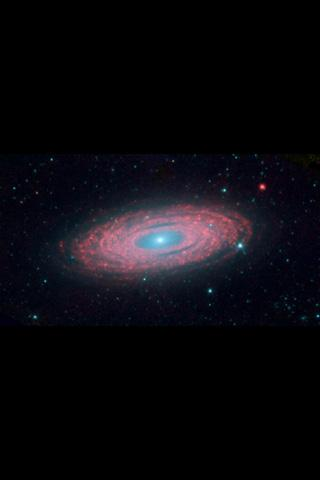 This image from NASA's Spitzer Space Telescope shows the spiral galaxy NGC 2841, located about 46 million light-years from Earth in the constellation Ursa Major. The galaxy is helping astronomers solve one of the oldest puzzles in astronomy.