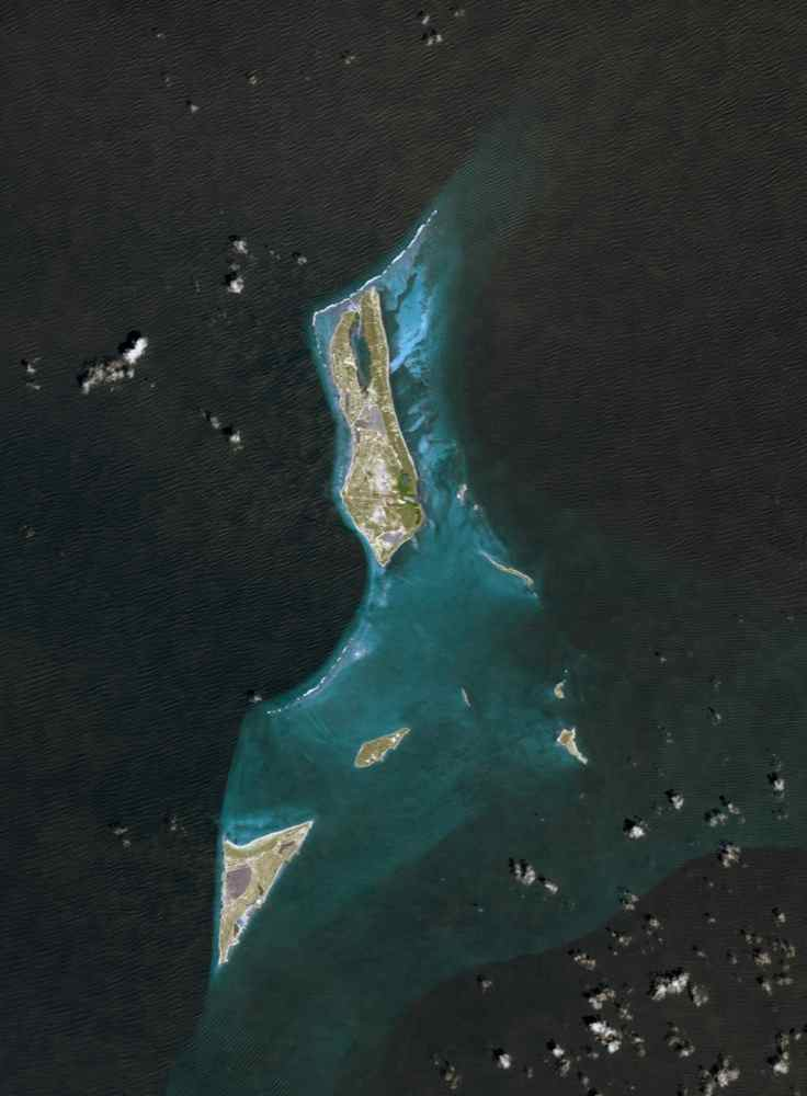 Grand Turk Island is an island in the Turks and Caicos Islands in the Caribbean, and contains the territory's capital, Cockburn Town. NASA's Terra spacecraft acquired this image on September 18, 2001.