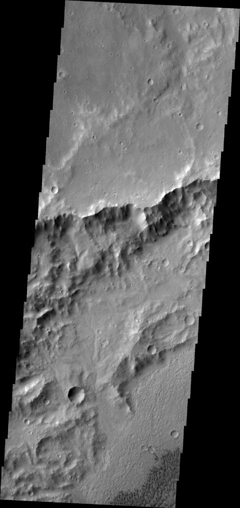 NASA's 2001 Mars Odyssey spacecraft captured this image of dunes on the floor of an unnamed crater in Tyrrhena Terra.