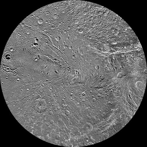 The northern hemisphere of Saturn's moon Dione is seen in this polar stereographic maps, mosaicked from the best-available clear-filter images from NASA's Cassini and Voyager missions.