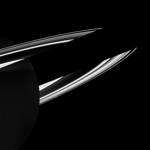Saturn casts its shadow on the rings in this NASA Cassini spacecraft image that also shows how the rings reflect sunlight onto the dark side of the planet. Here Saturn appears dimly illuminated by this ringshine.