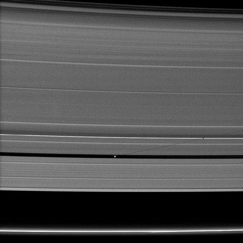 Saturn's small moon Pan casts a long shadow across the A ring in this image captured by NASA's Cassini spacecraft a few days after the planet's August 2009 equinox.