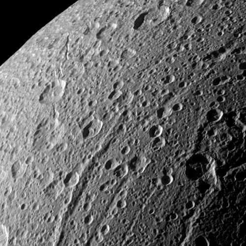 NASA's Cassini spacecraft swooped in for a close-up of the cratered, fractured surface of Saturn's moon Dione in this image taken during the spacecraft's Jan. 27, 2010, non-targeted flyby.