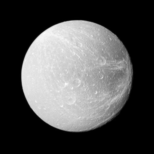 Wispy terrain stretches across the trailing hemisphere of Saturn's moon Dione on the right of this image taken by NASA's Cassini spacecraft during the spacecraft's flyby on April 7, 2010.