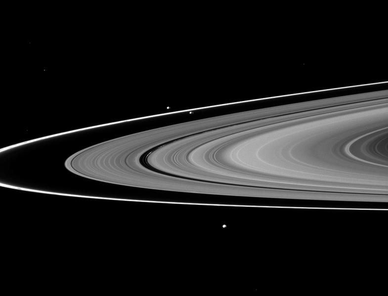 The F ring's shepherds, Prometheus and Pandora, join Epimetheus in this image taken by NASA's Cassini spacecraft of three of Saturn's moons and the rings.