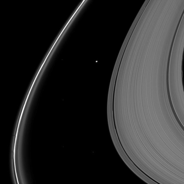 Delicate shadows are cast outward from Saturn's thin F ring in the lower left of this image taken as the planet approached its August 2009 equinox. The moon Atlas (30 kilometers, or 19 miles across) is seen just above the center of the image.
