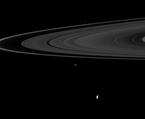 Six of Saturn's moons orbiting within and beyond the planet's rings are collected in this Cassini spacecraft image; they include Enceladus, Epimetheus, Atlas, Daphnis, Pan, and Janus.