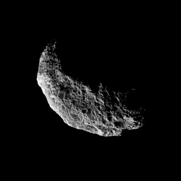 NASA's Cassini spacecraft captures a view of the southern latitudes of Saturn's tumbling moon Hyperion. Lit terrain seen here is mostly in the southern hemisphere of Hyperion. The south pole of the moon is near the bottom of the illuminated terrain.