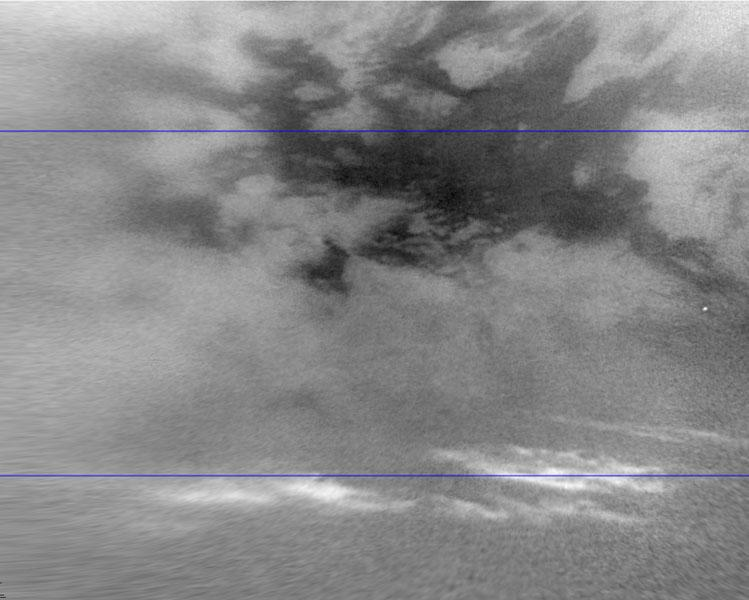 This image shows clouds in the mid-southern latitudes of Saturn's largest moon, Titan, one of a series of images captured by NASA's Cassini spacecraft a few months after fall began in the southern hemisphere.