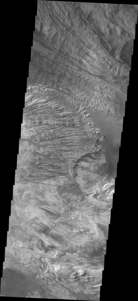 NASA's 2001 Mars Odyssey spacecraft took this image of Candor Chasma showing a complex region of eroded layered deposits.