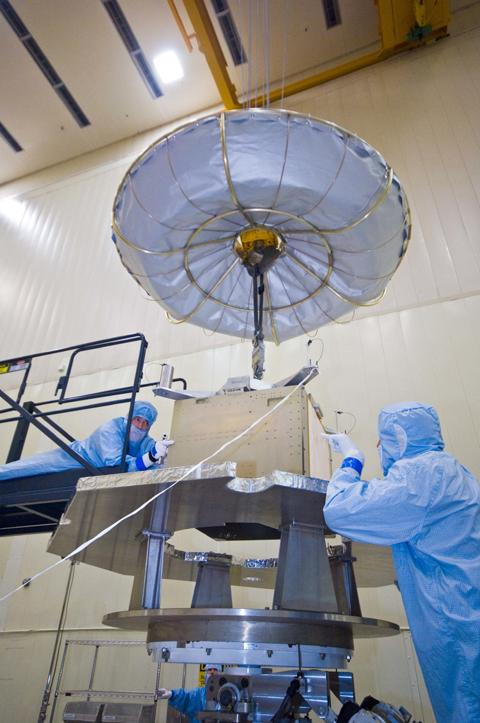 Assembly began April 1, 2010, for NASA's Juno spacecraft in the high-bay cleanroom at Lockheed Martin in Denver, Colo. Workers are moving the radiation vault above a mock-up of the upper part of the spacecraft's main body.