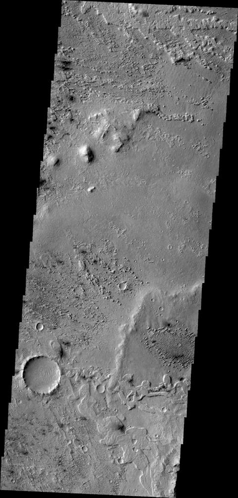 This image from NASA's 2001 Mars Odyssey shows some of the effects that wind action has on the surface of Mars. This image is located near Zephyria Planum. Winds in the region have eroded and etched the surface materials.