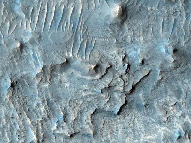 Ius Chasma is one of several canyons that make up Valles Marineris, the largest canyon system in the Solar System as seen by NASA's Mars Reconnaissance Orbiter.