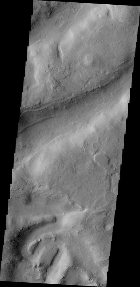 Northern Terra Sabea is dissected by numerous fractures and channels as shown by this image from NASA's 2001 Mars Odyssey.