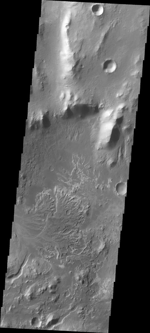 NASA's 2001 Mars Odyssey captured this image of a channel entering Eberswalde Crater and depositing a fan-shaped delta on the crater floor.