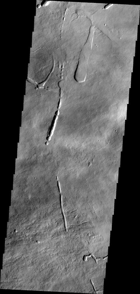 This image captured by NASA's 2001 Mars Odyssey shows a portion of the northeastern flank of Ascraeus Mons.