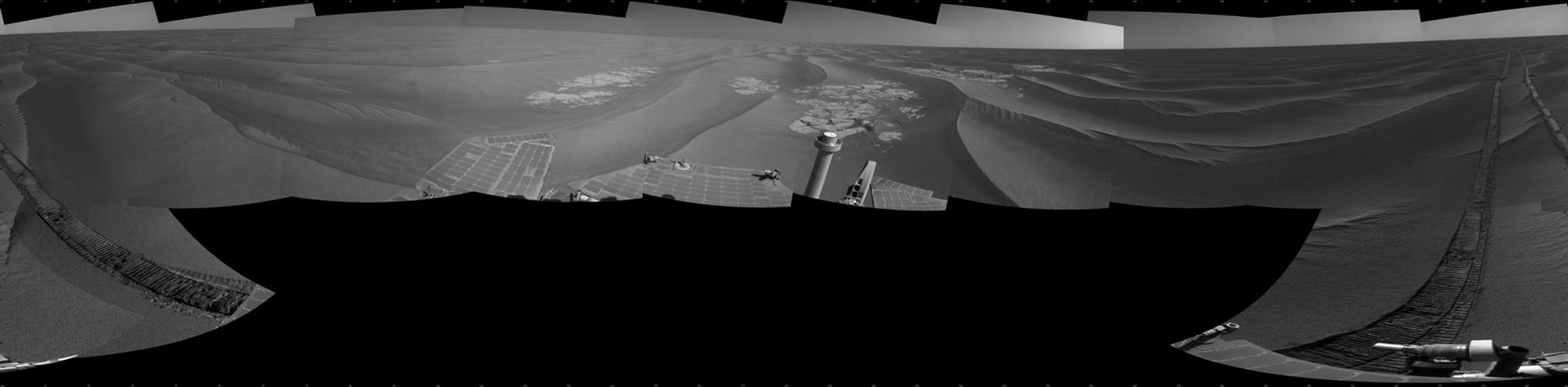 NASA's rover Opportunity used its navigation camera to take the images combined into this full 360-degree view of the rover's surroundings after a drive on the 2,220th Martian day, or sol, of Opportunity's mission on Mars (April 22, 2010).
