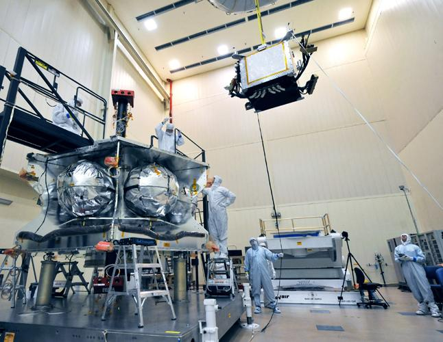 Technicians lowered a special radiation vault onto the propulsion module of NASA's Juno spacecraft. The vault will dramatically slow the aging effect radiation has on the electronics for the duration of the mission.