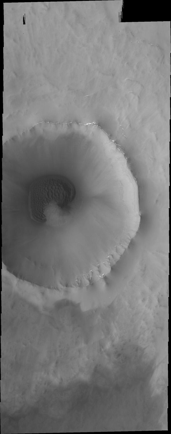 This image from NASA's Mars Odyssey is an unnamed crater in the far northern lowlands containing a sand sheet with dune forms on its floor. Many craters this close to the pole contain similar dune fields.