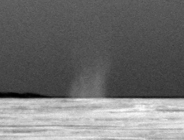 This is the first dust devil that NASA's rover Opportunity has observed in the rover's six and a half years on Mars. This image has been carefully calibrated and the contrast stretched to make the dust devil easier to see against the Martian sky.