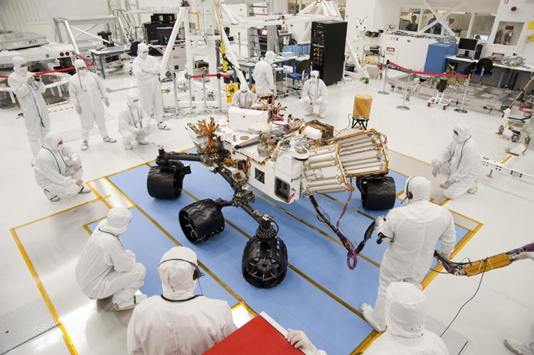 Technicians and engineers in clean-room garb monitor the first drive test of NASA's Curiosity rover, on July 23, 2010. Technicians and engineers conducted the drive test at the Jet Propulsion Laboratory in Pasadena, Calif.