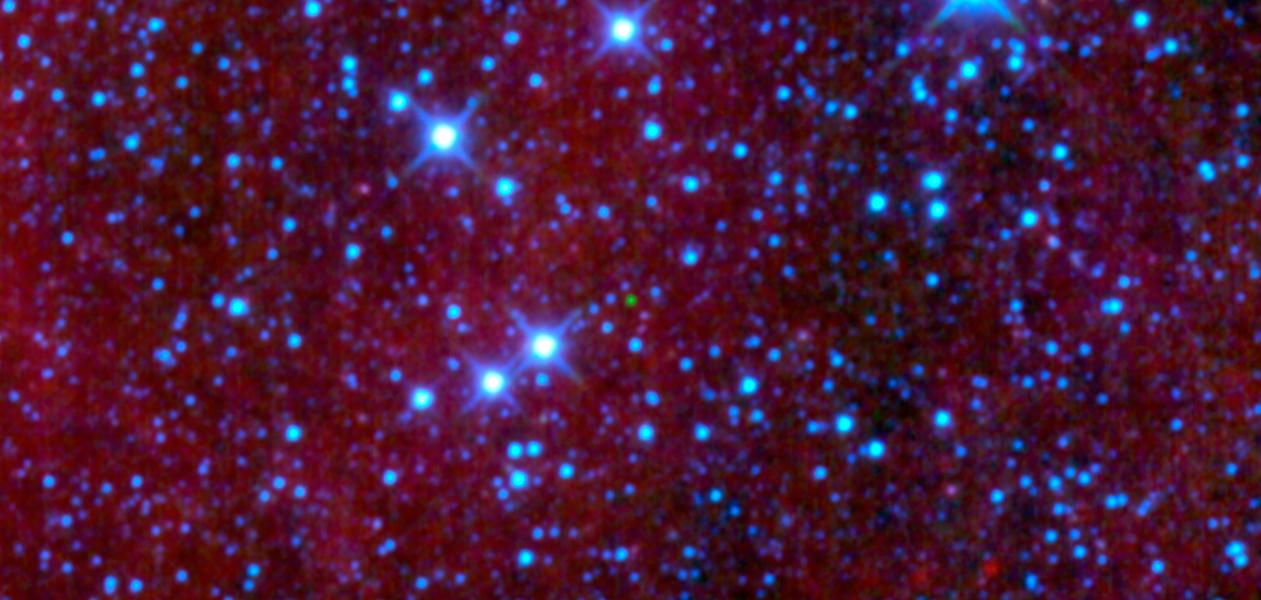 The green dot in the middle of this image might look like an emerald amidst glittering diamonds, but is a dim star belonging to a class called brown dwarfs; it is the first ultra-cool brown dwarf discovered by NASA's Wide-field Infrared Survey Explorer.