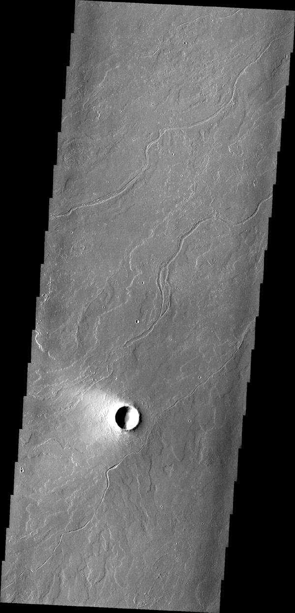 This region of Tharsis near Olympus Mons contains subtle features showing its lava flow origin. Note the 'softened' flow fronts and lava channels in this image captured by NASA's Mars Odyssey spacecraft.