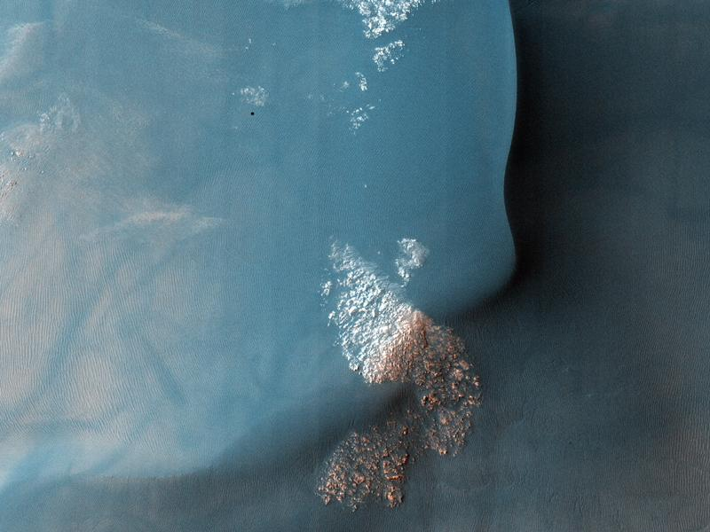 This observation from NASA's Mars Reconnaissance Orbiter shows a Southern hemisphere crater with gullies, dunes, periglacial modification, bright rock deposits, and dust devil tracks.