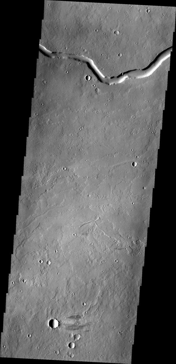 NASA's Mars Odyssey shows Rhabon Valles, a lava channel located between Ascraeus Mons and Uranius Mons.