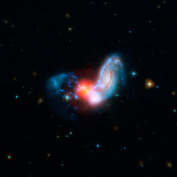A brilliant burst of star formation is revealed in this image combining observations from NASA's Spitzer and Hubble Space Telescopes. The collision of two spiral galaxies has triggered this luminous starburst.