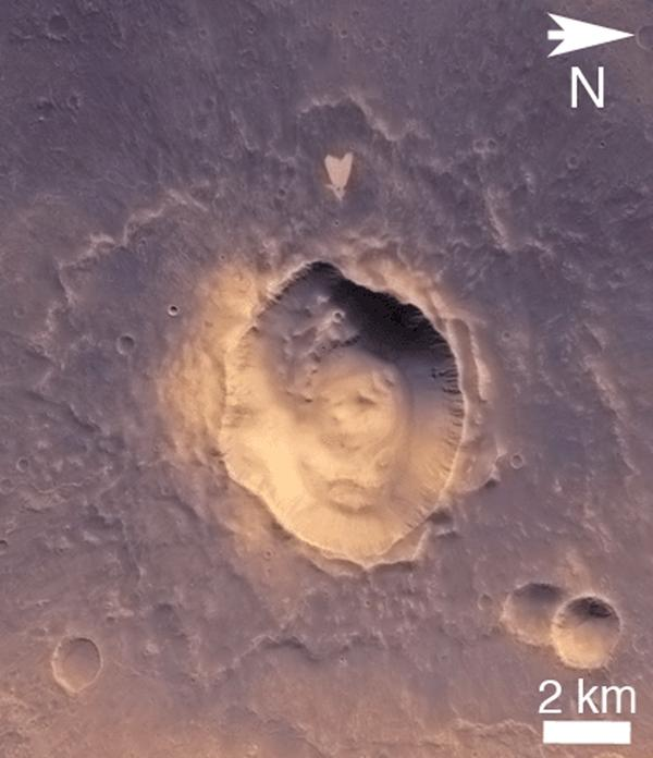 This wide-view picture of a heart-shaped feature in Arabia Terra on Mars was taken on May 23, 2010, by NASA's Mars Reconnaissance Orbiter. A small impact crater near the tip of the heart is responsible for the formation of the bright, heart-shaped feature