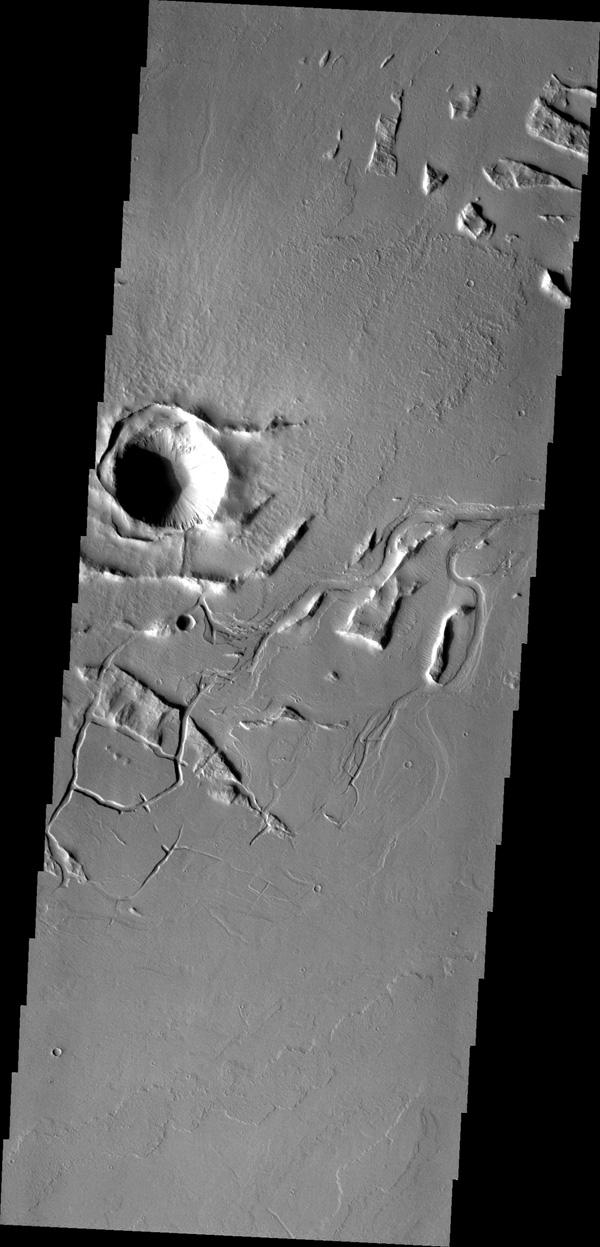 Lava channels and tectonic fractures are both found in the Tharsis region as shown in this image from NASA's Mars Odyssey.