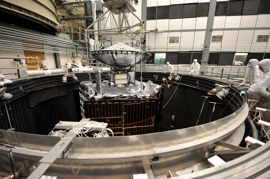 NASA's Juno spacecraft is raised out of a thermal vacuum chamber following tests that simulated the environment of space over the range of conditions the probe will encounter during its mission.