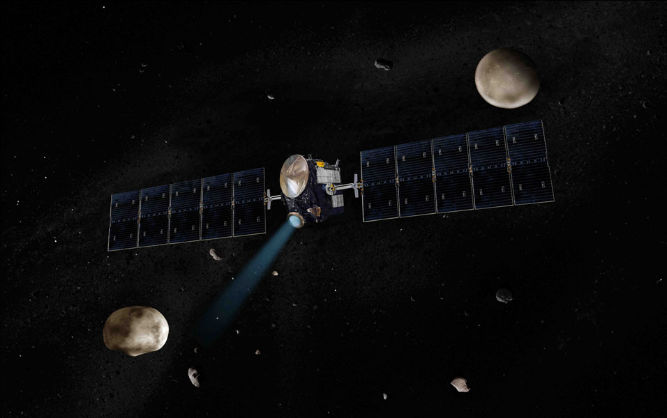 Artist's concept of NASA's Dawn spacecraft. The giant asteroid Vesta, Dawn's next destination, is on the lower left. Another larger asteroid and Dawn's second destination, Ceres, is on the upper right.