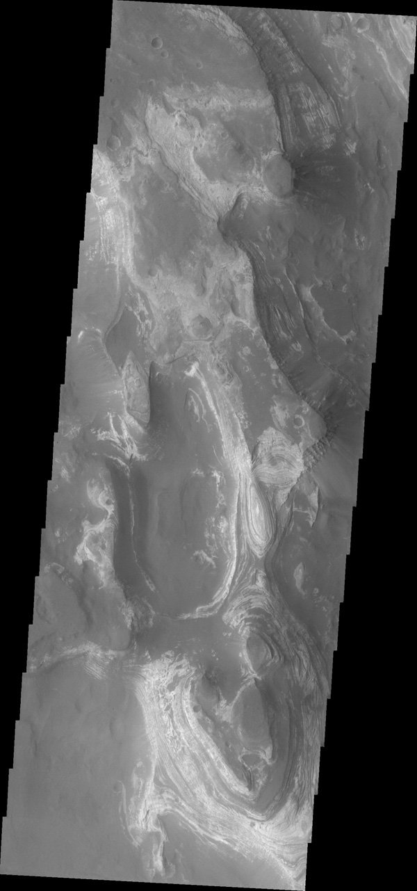 This image from NASA's 2001 Mars Odyssey shows a huge ridge of sand in Russell Crater that makes its dune field one of the most unusual on Mars.