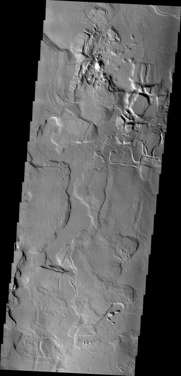 Between the Tharsis region and Lunae Planum lies Echus Chasma and the source of Kasei Vallis. Flows from the Tharsis volcanoes are buckled by tectonic forces forming mounds and fractures in the Chasma as seen in this image from NASA's 2001 Mars Odyssey.