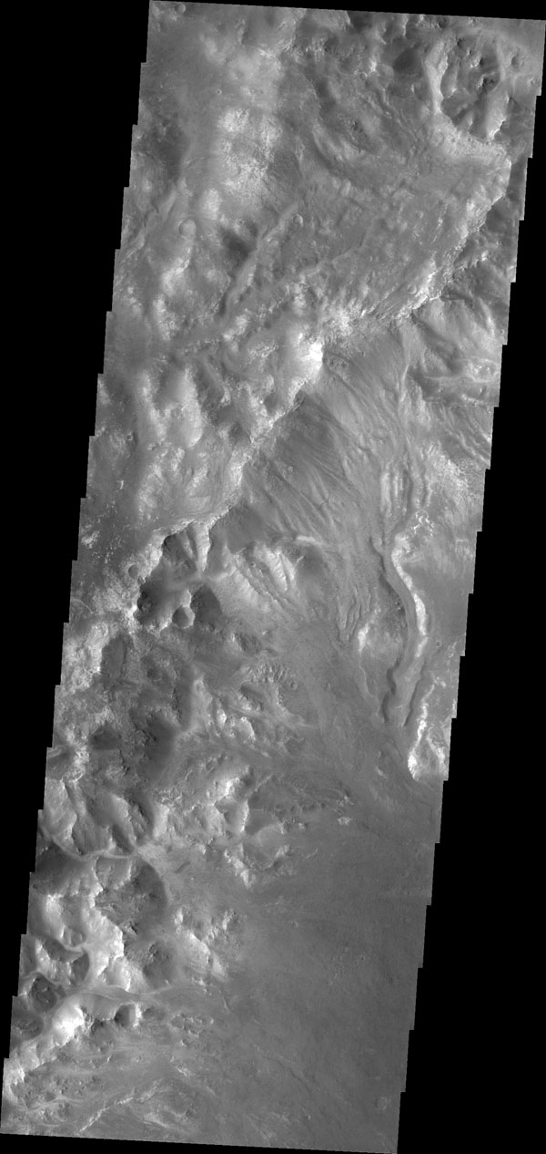 This image from NASA's 2001 Mars Odyssey shows channels dissecting the northwestern rim of Holden Crater.