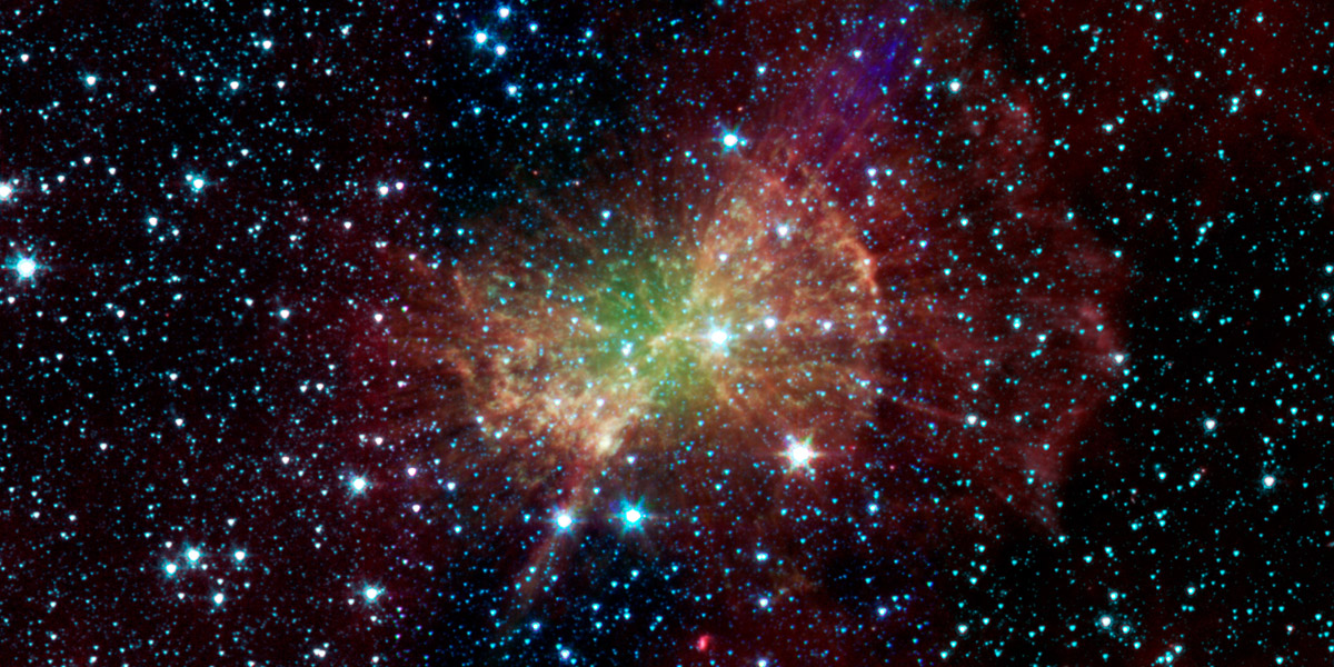 The 'Dumbbell nebula,' also known as Messier 27, pumps out infrared light in this image from NASA's Spitzer Space Telescope. Planetary nebulae are now known to be the remains of stars that once looked a lot like our sun.