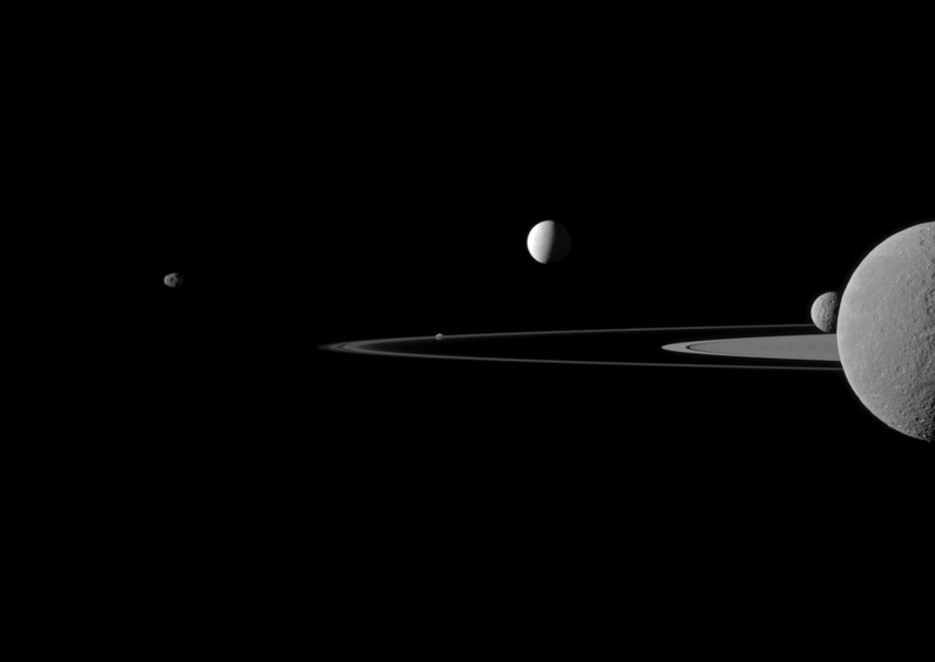 A quintet of Saturn's moons come together in this portrait from NASA's Cassini spacecraft. Janus is seen on the far left, Pandora orbits near the middle, Enceladus appears above the center, and Rhea and Mimas are seen on the right side.