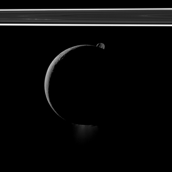 During a flyby of Saturn's moon Enceladus on Oct. 1, 2011, NASA's Cassini spacecraft snapped this portrait of the moon joined by its sibling Epimetheus and the planet's rings.