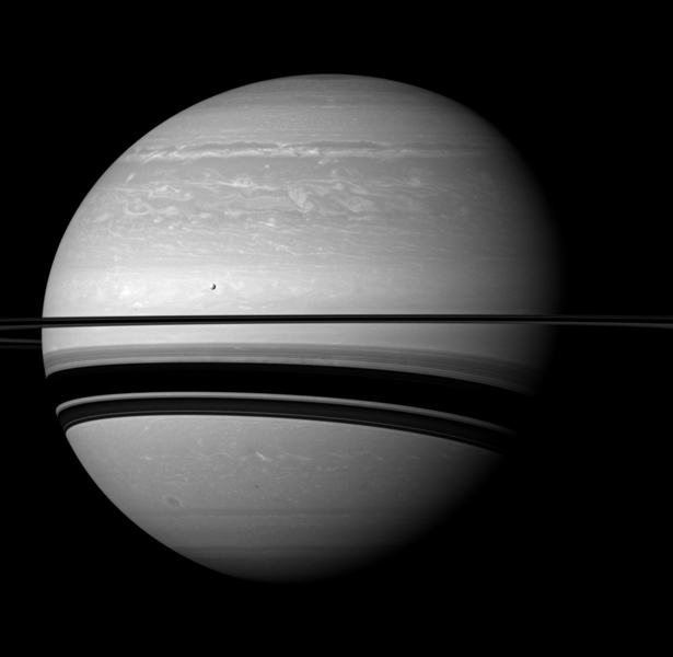 Even in a peaceful looking scene such as this one of Saturn and its moon Tethys, NASA's Cassini spacecraft reveals clues about how Saturn is ever-changing; scars are seen here of the huge storm that raged through much of 2011.