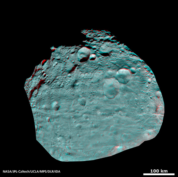 This image of the giant asteroid Vesta obtained by NASA's Dawn spacecraft shows numerous impact craters illustrate the asteroid's violent youth. You need 3-D glasses to view this image.