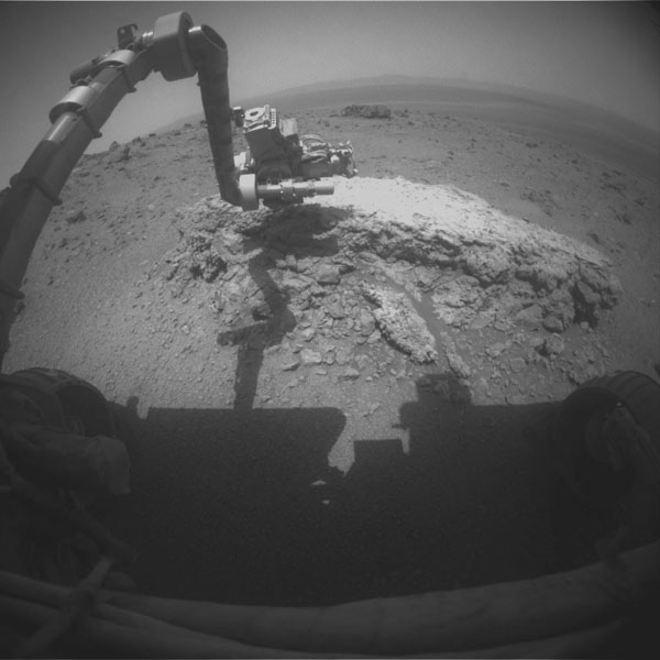 "NASA's Mars Exploration Rover Opportunity used its front hazard-avoidance camera to take this picture showing the rover's arm extended toward a light-toned rock, ""Tisdale 2,"" during sol 2,695 (Aug. 23, 2011). Tisdale 2 is about 12 inches tall."