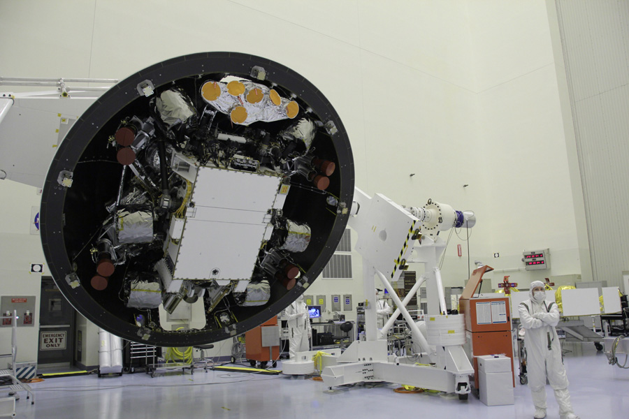 At the Payload Hazardous Servicing Facility at NASA's Kennedy Space Center in Florida, the 'back shell powered descent vehicle' configuration of NASA's Mars Science Laboratory is being rotated for final closeout actions.
