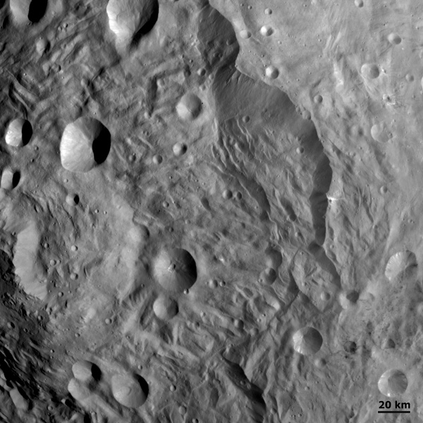 Slumping features and landslides can be clearly seen near the base of the largest scarp in this image from NASA's Dawn spacecraft. Some of the hummocky terrain near the scarps is probably due to landsliding.