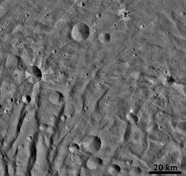 This image from NASA's Dawn spacecraft shows many fresh craters, several with bright ejecta rays, which were formed by impacts into the floor of asteroid Vesta's south polar basin.