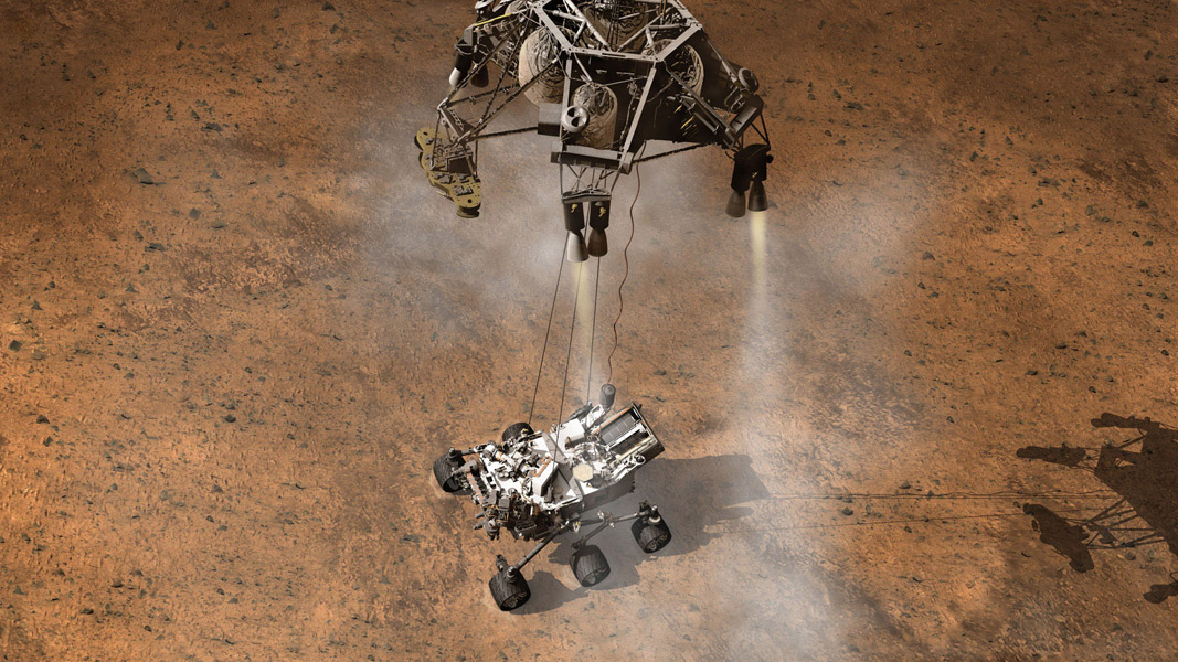 This artist's concept depicts the moment that NASA's Curiosity rover touches down onto the Martian surface. The Mars Science Laboratory will use the sky crane touchdown system.