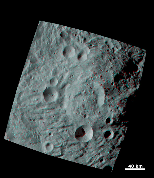 The broad morphology of asteroid Vesta's mountain/central complex is clear in this image from NASA's Dawn spacecraft; it is a roughly circular topographic mound, which is approximately 200km in diameter and has approximately 20km of relief from its base.