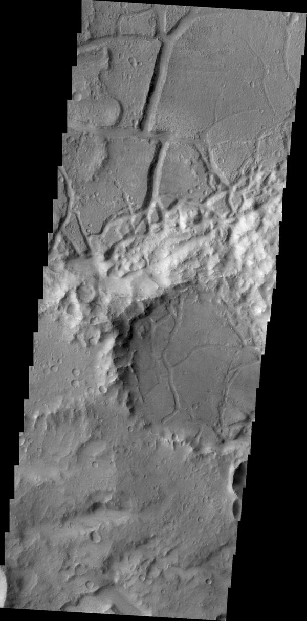 This image from NASA's 2001 Mars Odyssey spacecraft shows evidence of tectonic stresses that deform and fracture rocks and planetary surfaces. Right angles seen here are a good indication that the feature was formed by tectonic stresses.